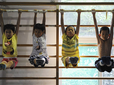 Young divers attend a training session at a gymnasium in Hefei