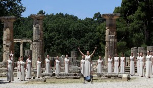 Greek actress Ino Menegaki prepares to light the Olympic Flame during a dress rehearsal for the London 2012 Olympic Games at the site of ancient Olympia in Greece